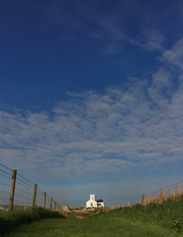 Ballintoy church under a blue sky