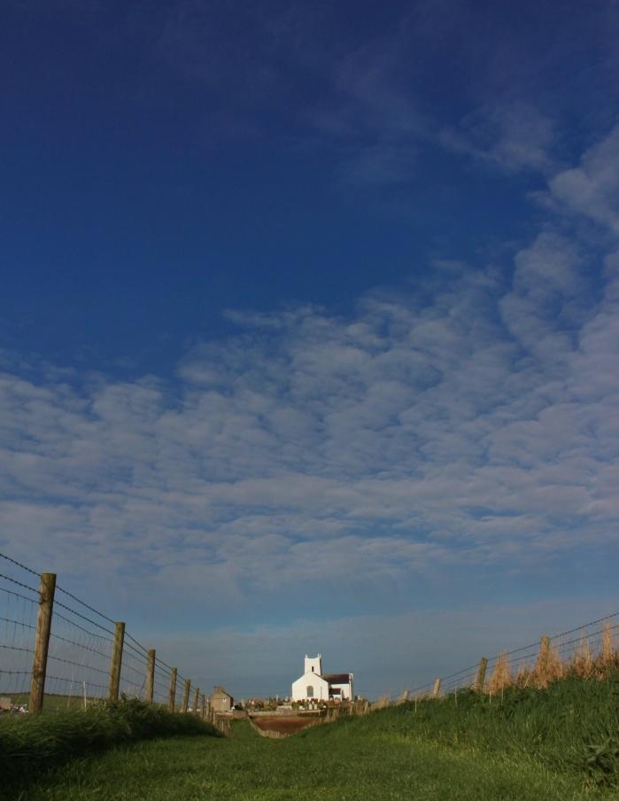 Ballintoy church under a blue sky